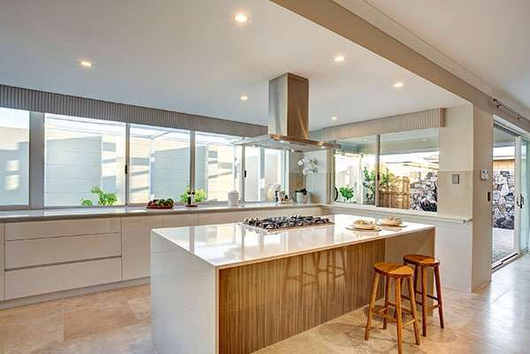 Ample natural light flows into this kitchen through its many windows