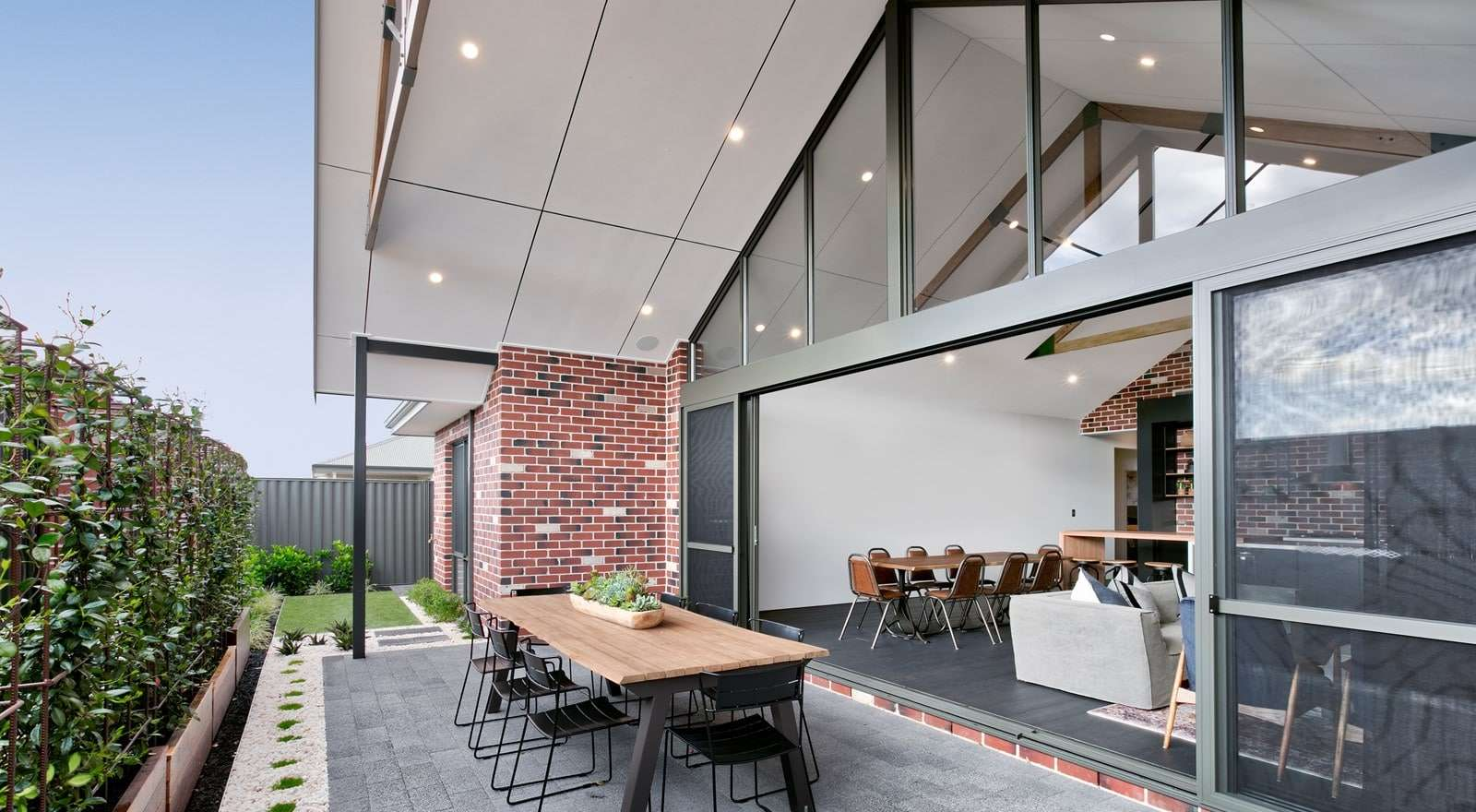 Large sliding doors connect the living area with the alfresco for outdoor entertaining.
