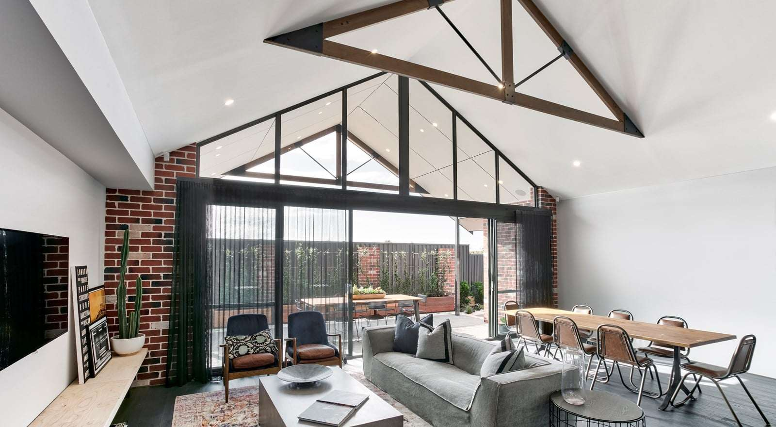A bright white ceiling contrasted by exposed timber feature trusses.