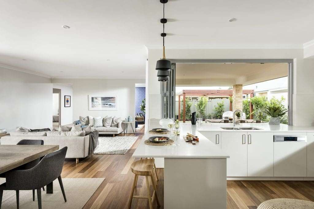 Kitchen bi-fold servery window with a view of the dining room and living room - Dale Alcock Homes
