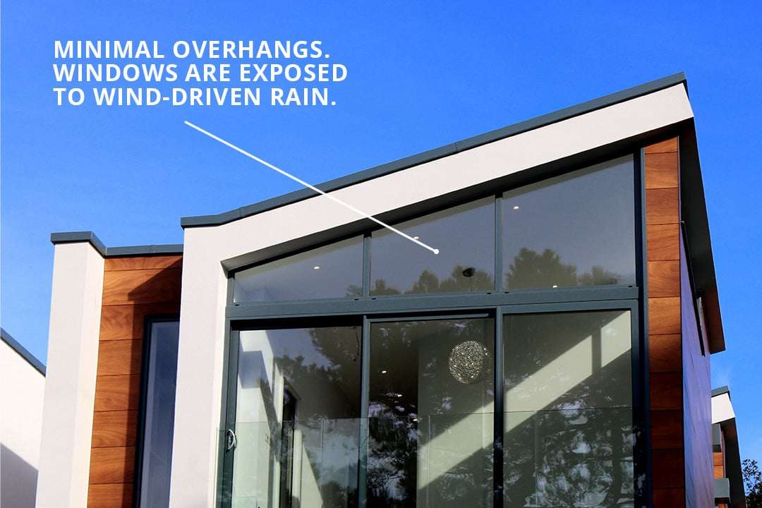 Minimal overhangs can leave windows exposed to wind-driven rain.