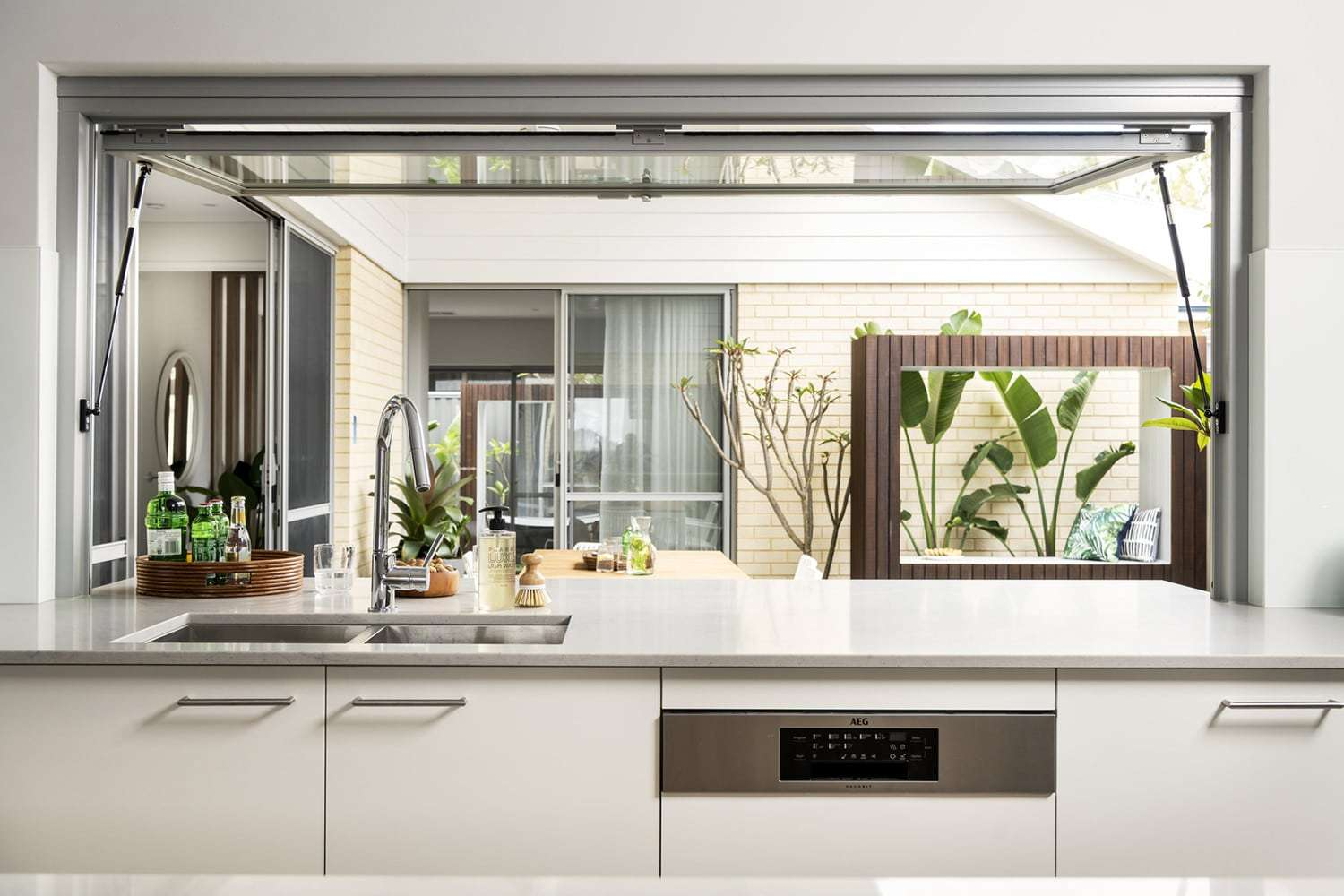 Gas strut awning window by Jason Windows, pictured in The Noosa by Dale Alcock Homes