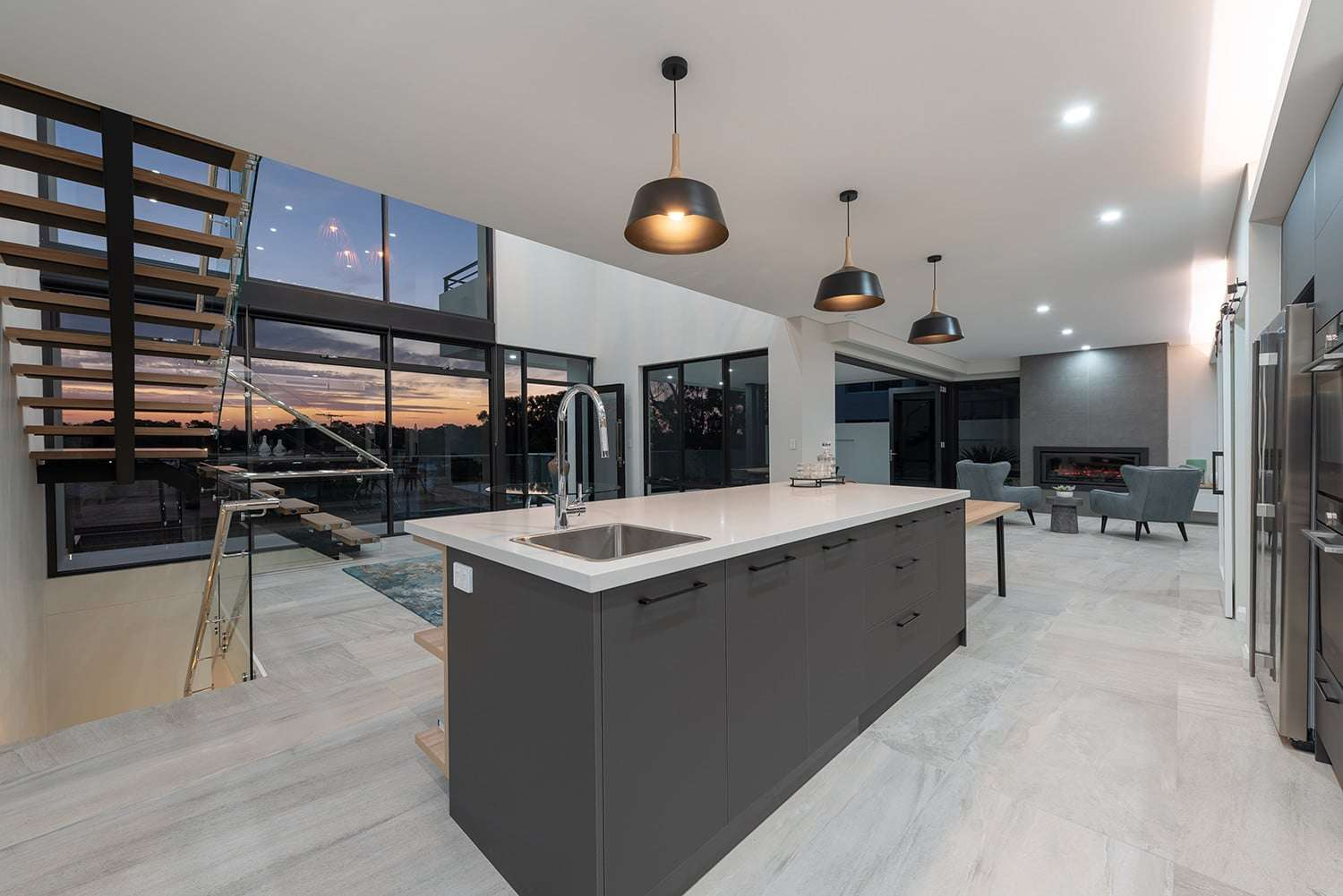 Expansive views from the impressive kitchen and adjacent dining room, with feature gas fireplace